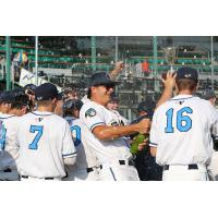 Kalamazoo Growlers celebrate a victory in the regular season finale