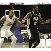 Billy White of the Halifax Hurricanes (left) and Terry Thomas of the Moncton Magic