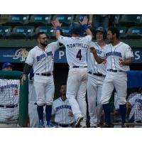 Mike Montville receives congratulations from his Rockland Boulders teammates following his home run
