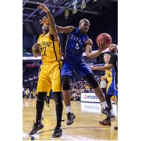 Kitchener-Waterloo Titans SG/SF Tramar Sutherland battles for the ball against the London Lightning