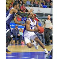 Kitchener-Waterloo Titans SG/SF Tramar Sutherland handles the ball against the Saint John Riptide