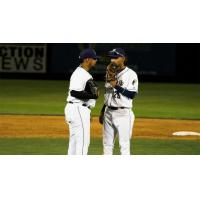Tri-City Dust Devils confer on the mound