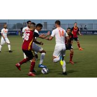 Josh Morton and Jesus Fereirra of Tulsa Roughnecks FC battle for possession in Saturday's 3-2 loss to the Real Monarchs