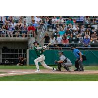 Cole Carder of the Medford Rogues takes a big swing