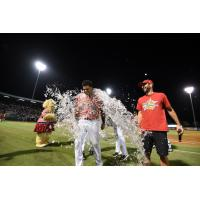 Dermis Garcia of the Charleston RiverDogs receives a bath following his game-winning hit