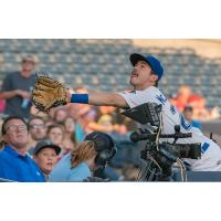 Zach McKinstry of the Tulsa Drillers attempts to catch a foul ball in the crowd