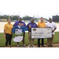 Biloxi Shuckers present check to Uplift Foundation