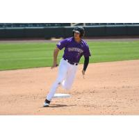 Josh Fuentes of the Albuquerque Isotopes rounds first