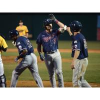 Jayce Boyd of the Somerset Patriots receives a high five