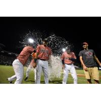 Charleston RiverDogs first baseman Dermis Garcia receives the water bucket treatment
