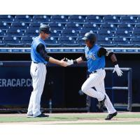 Patrick Osborn (left) congratulates Daniel Barrios on his home run during the Tampa Tarpons win