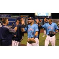 Everett AquaSox exchange high fives leaving the field after a win