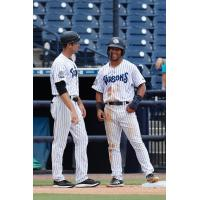 Patrick Osborn (left) and Dom Thompson-Williams of the Tampa Tarpons share a laugh