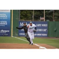 Lynchburg Hillcats first baseman Anthony Miller takes it to first himself