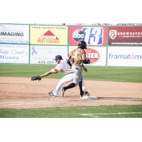 Lynchburg Hillcats first baseman Anthony Miller stretches for the out