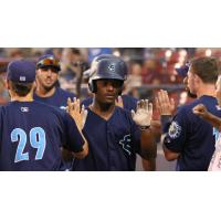 Everett AquaSox exchange high fives after a Game Two win