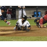 Justin Trapp slides home with the winning run for the Somerset Patriots