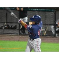 Ramon Flores of the Somerset Patriots swings for the fences