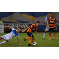 Tulsa Roughnecks FC's Michael Gamble keeps possession vs. Reno 1868 FC