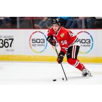 Clay Hanus of the Portland Winterhawks handles the puck