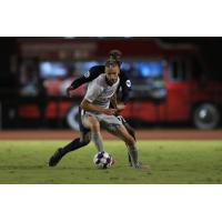 Sacramento Republic FC defender Elliot Hord screens off the opposition