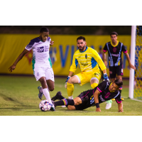 Las Vegas Lights FC goalkeeper Thomas Olsen (yellow) tracks action vs. OKC Energy FC