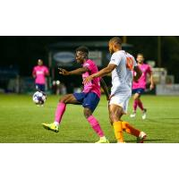 Tulsa Roughnecks FC's Terence Smith (42)battles for possession against Saint Louis FC