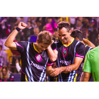 Las Vegas Lights FC's Alex Mendoza (left) and Juan Carlos Garcia celebrate a 5-2 victory over Phoenix Rising FC