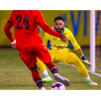 Las Vegas Lights FC goalkeeper Thomas Olsen prepares to make a save against Phoenix Rising
