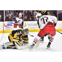 Ryan MacInnis of the Cleveland Monsters takes a shot against the Wilkes-Barre/Scranton Penguins