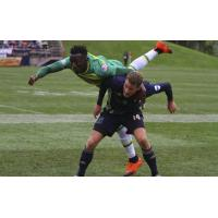 Fabian Herbers of Bethlehem Steel FC sends a member of the Tampa Bay Rowdies airborne