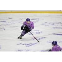 Tri-City Storm skate on Color Out Cancer ice
