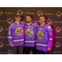 Colby Williams, Riley Barber and Logan Pyett of the Hershey Bears show off the team's Hockey Fights Cancer jerseys