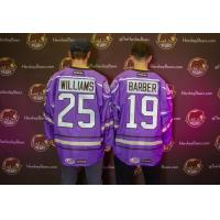 Colby Williams and Riley Barber of the Hershey Bears show off the team's Hockey Fights Cancer jerseys