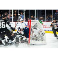 Brad Malone of the Bakersfield Condors collides with San Antonio Rampage goaltender Jordan Binnington as the Condors tie the game