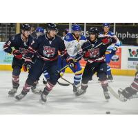 Macon Mayhem wall off the puck against the Roanoke Rail Yard Dawgs