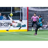 St. Louis Ambush keep an eye on a bicycle kick by Leo Gibson of the Kansas City Comets