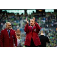 Sigi Schmid acknowledges the crowd at CenturyLink Field while donning his jacket from the National Soccer Hall of Fame on October 4, 2015