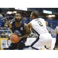 Halifax Hurricanes forward Gabe Freeman (left) eyes the hoop vs. the Saint John Riptide