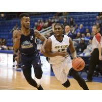 Halifax Hurricanes guard Joel Kindred (left) defends against the Saint John Riptide