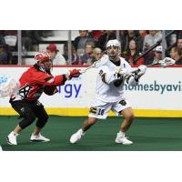 Logan Schuss of the Vancouver Warriors (right) vs. the Calgary Roughnecks