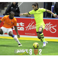 Angel Curiel of the Milwaukee Wave (right) against the Mississauga MetroStars