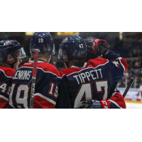 Owen Tippett of the Saginaw Spirit receives congratulations from his new teammates
