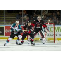 Kelowna Rockets LW Conner Bruggen-Cate (left) in front of the Prince George Cougars' goal