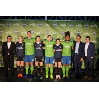 Sounders FC and Reign FC players wear their new Zulily-branded kits alongside team and Zulily leadership