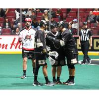 Vancouver Warriors huddle against the Calgary Roughnecks