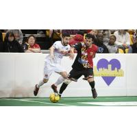 Adriano Dos Santos of the Baltimore Blast (right) defends against the Harrisburg Heat