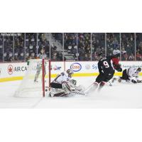 Prince George Cougars left win Tyson Upper scores against the Calgary Hitmen