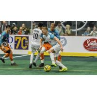 St. Louis Ambush control the ball against the Florida Tropics