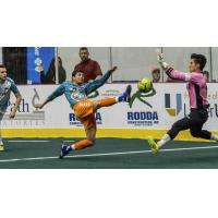 St. Louis Ambush goalkeeper Paulo comes out to challenge the Florida Tropics